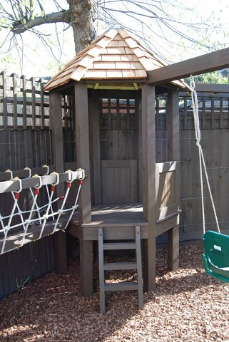 Playframe with rope bridge, play house, monkey bars, swing, fireman's pole 2