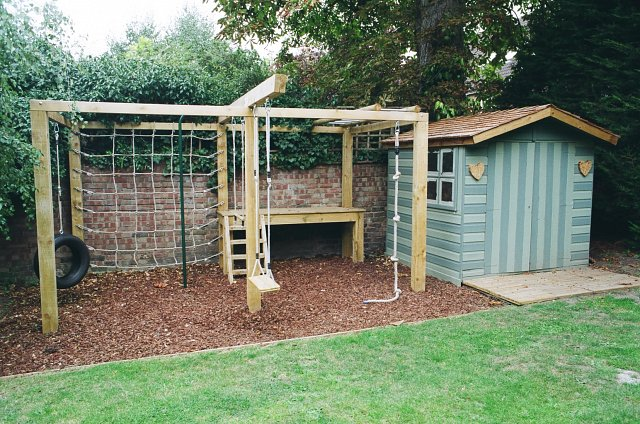 Children's playframe with playhouse with cedar shingle roof