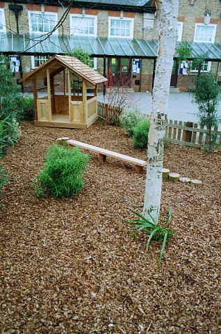 School play area with western red cedar play house, play bark, cedar balance beam and stepping logs